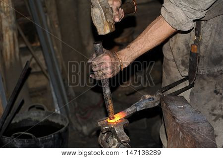 Blacksmith Working On Metal On Anvil At Forge High Speed
