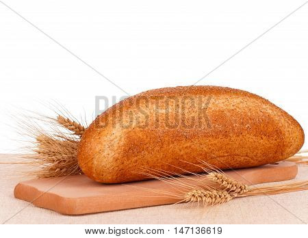Fresh bread with bran on a cutting board on white background