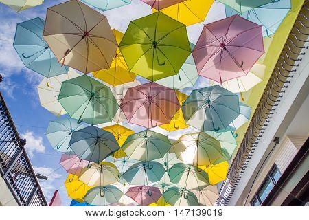 Lot of colorful umbrellas against blue sky