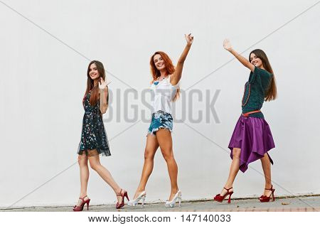 Group Of Women Walking On City Street about light wall