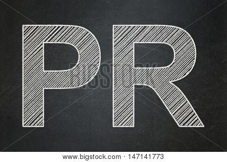 Advertising concept: text PR on Black chalkboard background