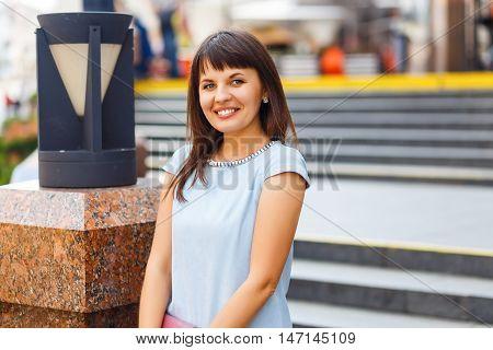 Portrait of beautiful caucasian woman standing on upstairs