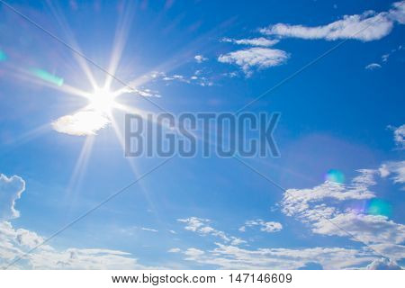 Natural Lens Flare And Radiating Rays In A Blue Sky With Clouds. You Can Apply For Sky Background, S
