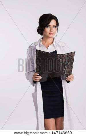 Female doctor nurse looking at radiographs x-ray.