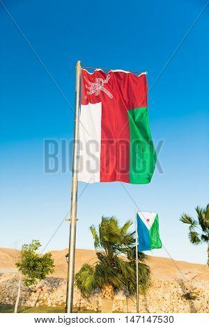 Waving National flag of Oman on flagpole