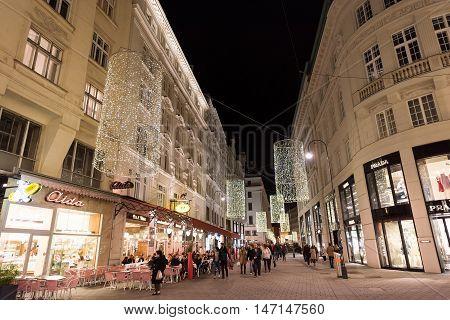 VIENNA, AUSTRIA - NOVEMBER 13, 2015: City centre view at night, with Prada shops