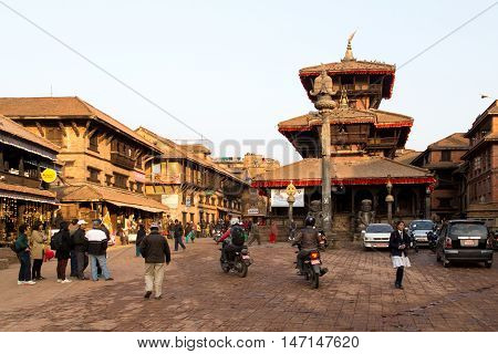 Bhaktapur, Nepal - December 04, 2014: A busy market square with a tmeple in the city center