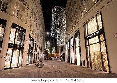 VIENNA, AUSTRIA - NOVEMBER 13, 2015: City centre view at night, with Prada and Louis Vuitton shops