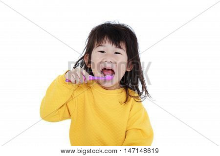Cute asian girl in pajamas with a toothbrush in hand open the mouth and brush teeth oral health concept. Isolated on white background. Chinese child waking up girl looks sleepy in the morning.