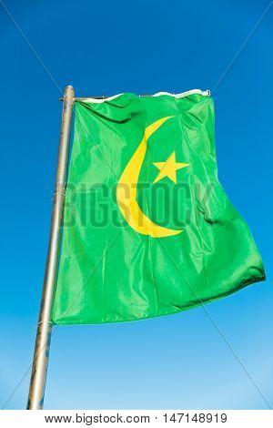 Waving National flag of Mauritania on flagpole