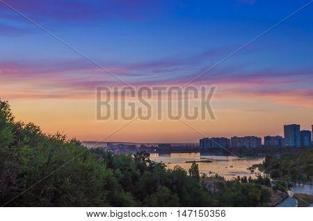 Sayran lake - evening city view Almaty Kazakhstan