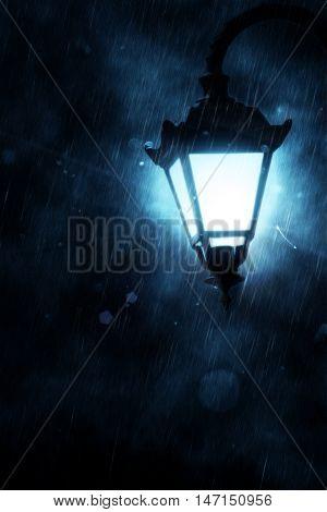 Street Lamp At Rainy Night