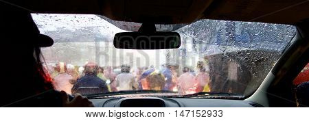 Looking through the windscreen during storm, Phnom Penh, Cambodia