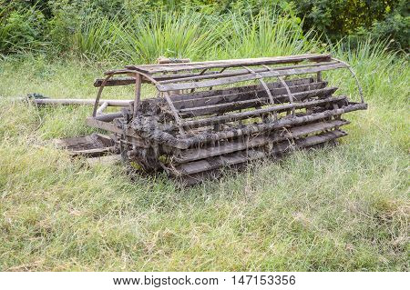 wooden Seat Walking tractor stained on green grass