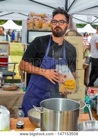 Kyiv Ukraine - September 10 2016: Italian chef preparing a pasta during a Kyiv farmer's market. Big farmer's market of healthy food was organized by Good Wine company in Kyiv Ukraine.