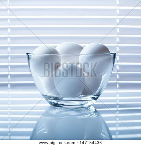 Eggs Bowl On Reflective Plate