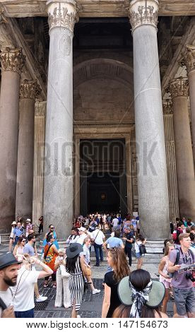 ROME ITALY - AUGUST 14 2016: people at the entrance of the Pantheon ancient Roman temple