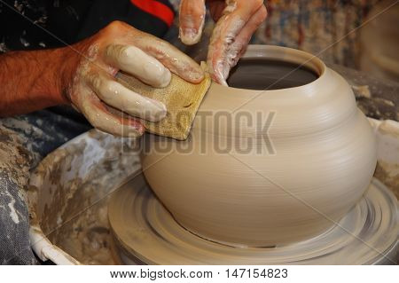 Potter's Lathe detail , Finishing clay Pottery