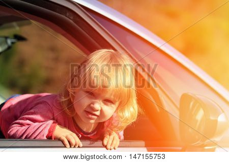 happy little girl travel by car, family travel concept
