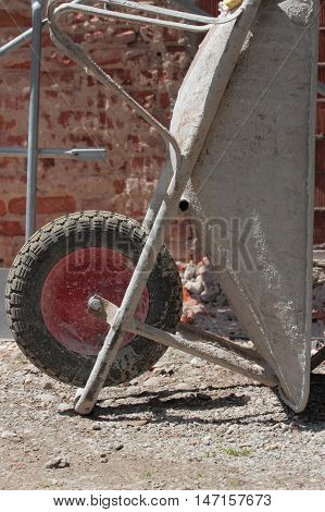an old wheelbarrow details on construction site