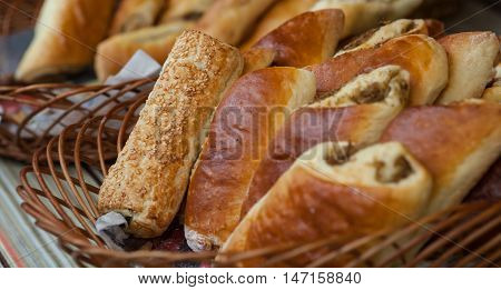 Closeup of fresh breads in basket at bakery