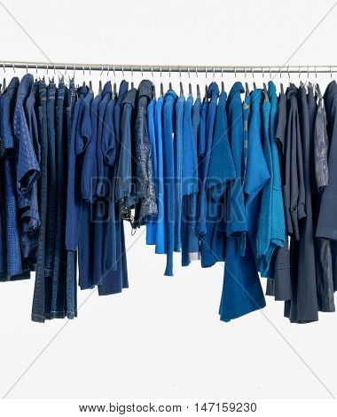 Set of female blue dress and trousers, coat  isolated on hanging