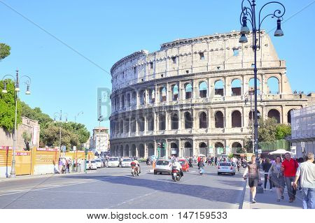 ROME ITALY - May 03.2012: Ruins of cyclopean building with of genius architecture. Facade of Coliseum