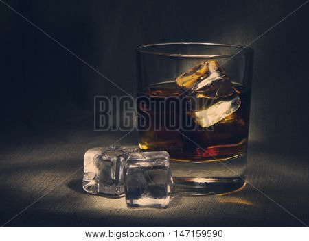 Scotch On Textile Background   Old And Vintage Countertop With Highlight And A Glass Of Hard Liquor