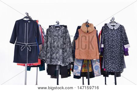Four mSet of female dress with,coat isolated on hanging