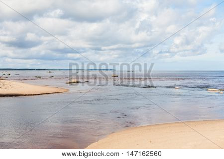 River flowing into and merging with the sea