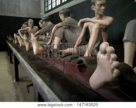 Hanoi, Vietnam - Sep 14, 2016: Memorial jail interior with sculptures in Hoa Lo Prison depicting brutal treatment by French. Meditative area decorated with expressive sculptures.