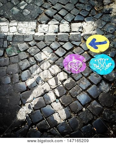Aerial view of colored indication on a cobblestone street