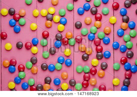 Candies On A Wooden Pink Table
