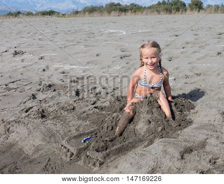 happiness when given permission to break the sand castle that is built for a long time with parents
