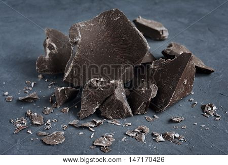 Chocolate pieces close-up on a dark background