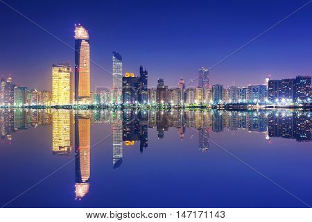 Skyline of Abu Dhabi at night, United Arab Emirates