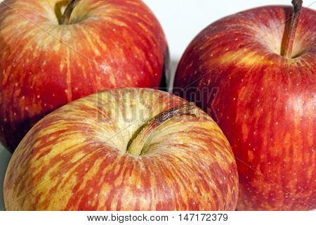 Close Up Sections Of Three Fresh Red Apples
