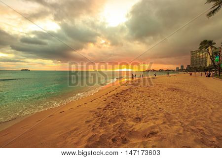 Waikiki, Oahu, Hawaii - August 20, 2016: twilight at Waikiki beach. Waikiki beach is a beautiful place to enjoy the sunset over the ocean.