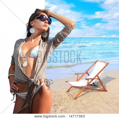 Beautiful woman with idealistic beach landscape  - Clipping path on the girl easy to cut her out - perfect for travel agencies