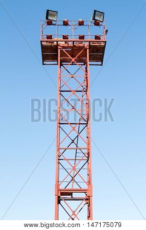 Large tall high outdoor spotlights on the blue sky background