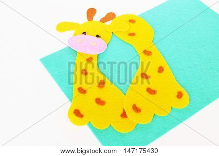 Felt parts for sewing a giraffe toy. How to sew felt yellow giraffe. Sewing concept. Step