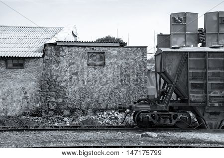 Wagon and old wall. Wagon on old station. Black and white photography