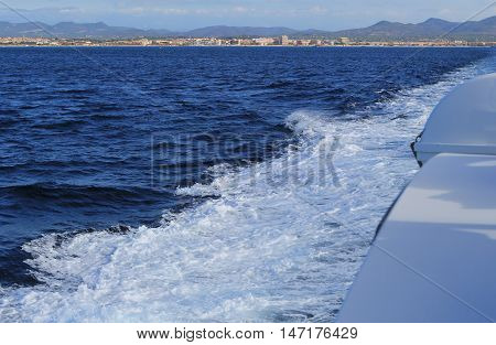 Foaming White Seawater In The Wake Of A Boat On The Clear Blue Sea
