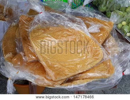 crispy, sweet, fibrous, Thai flat bread for sale at Ranot market, Thailand