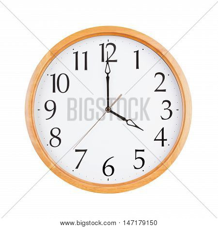 Exactly four o'clock on the round dial