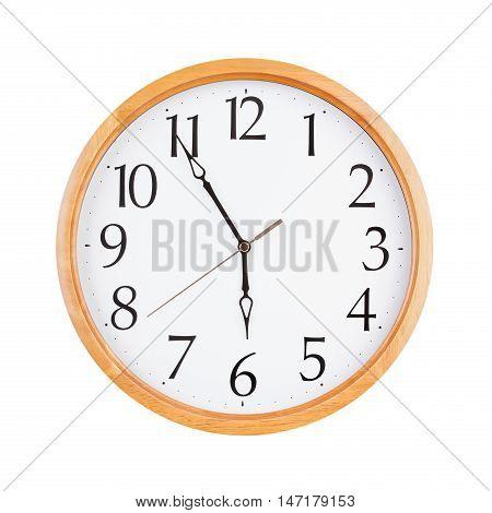 Big round clock shows exactly six o'clock