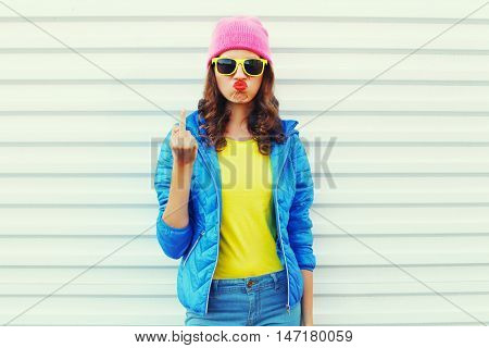 Fashion Bad Girl Expression Showing Hand With Middle Finger Fuck You Off Sign In Colorful Clothes Ov