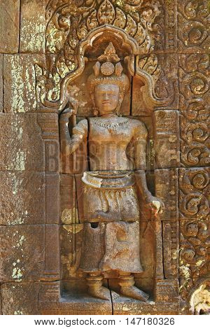 Rock carving of Apsara (Apsarasa), female spirit in Buddhist at Vat Phou ( Wat Phu), Khmer Hindu temple complex and UNESCO World Heritage Site in Champasak Province, southern Laos