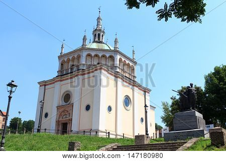 Crespi d'Adda, Italy - June 2, 2016: Church at historic industrial town Crespi d'Adda near Bergamo, Lombardy. The town is an example of the
