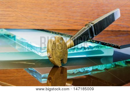 glass and glass cutter closeup on wooden background